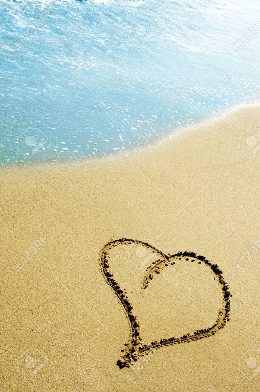 hearts drawn on the sand of the beach Stock Photo - 6336745