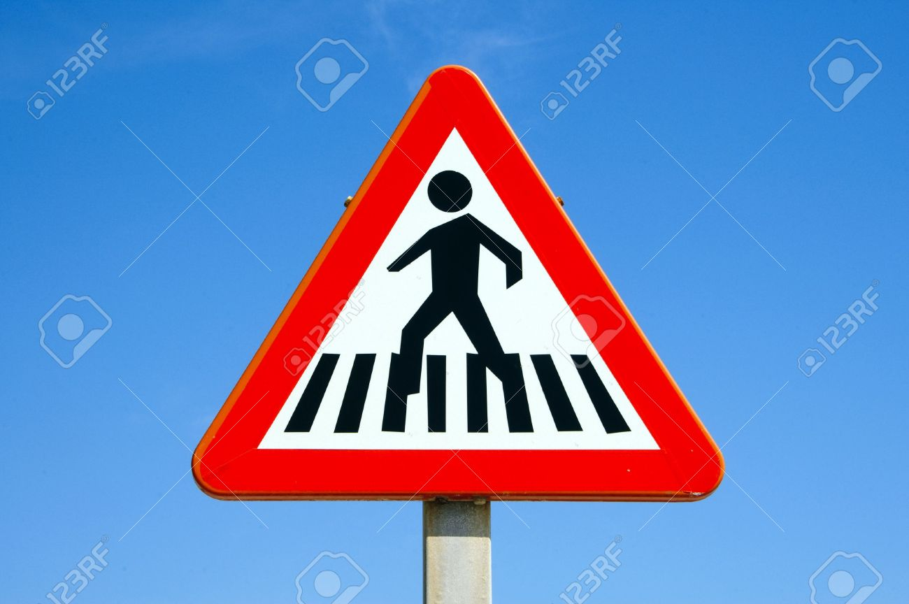 pedestrian crossing sign over the blue sky stock photo picture and