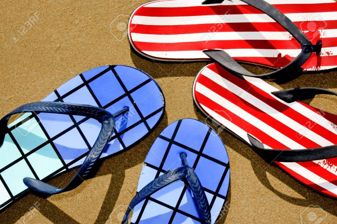 two pairs of flip-flops floating on the sand on a beach Stock Photo - 6895778