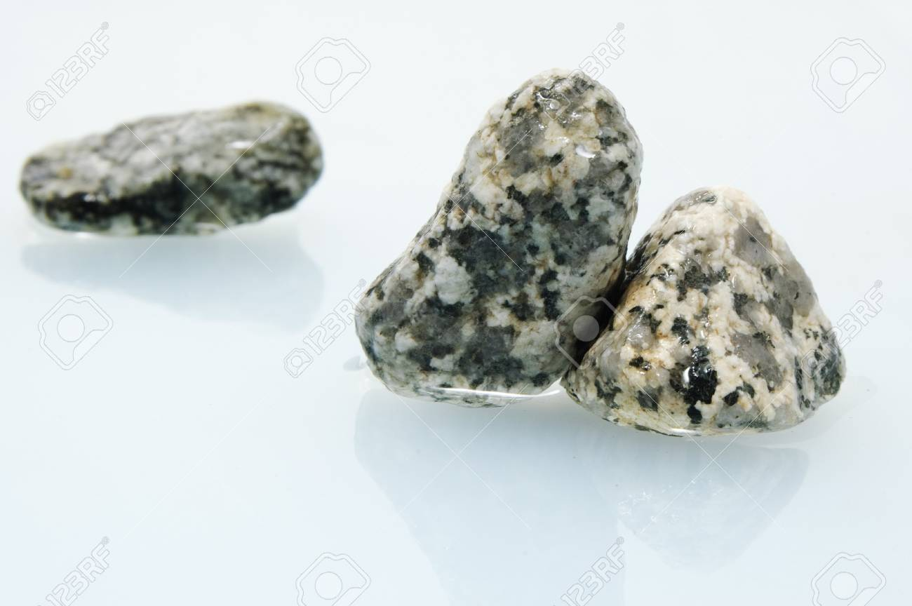 a pile of zen stones on a water background Stock Photo - 7464892