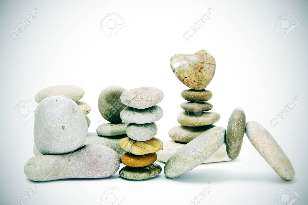 zen stones, one heart shapped, on a white background with vignetting Stock Photo - 7473019
