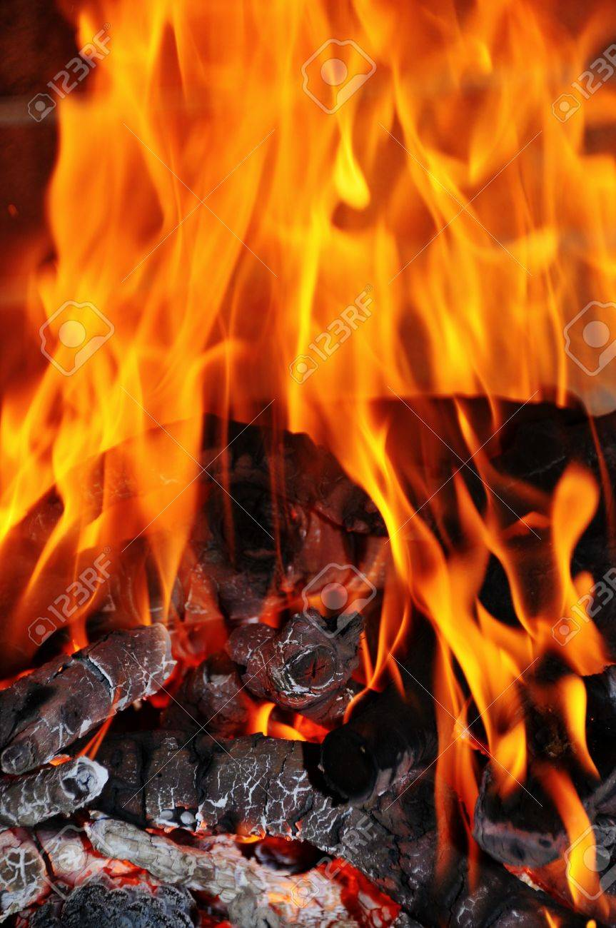 closeup of red fire flames of a fireplace stock photo picture and