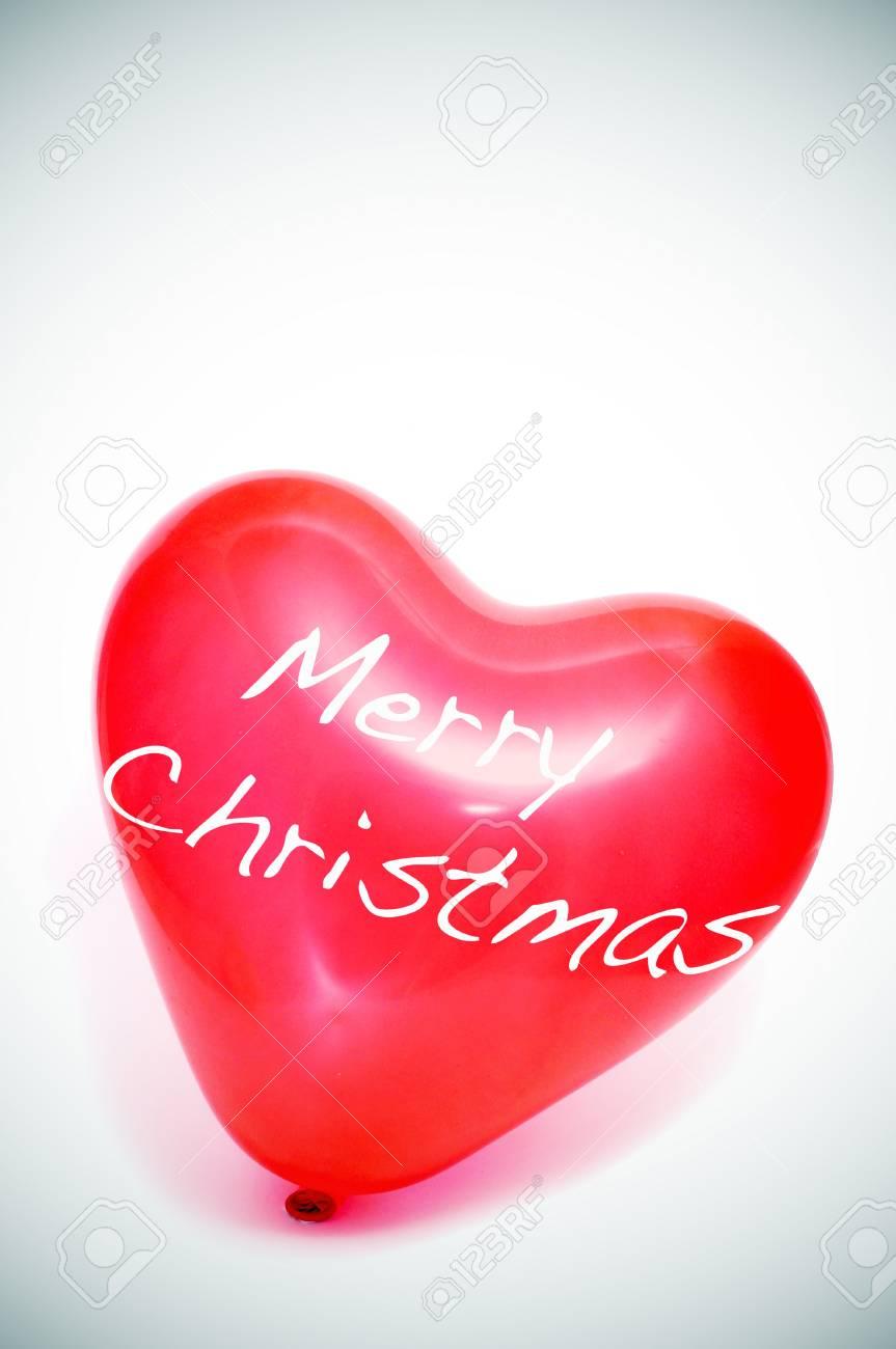 merry christmas written in a heart-shaped balloon Stock Photo - 8327187