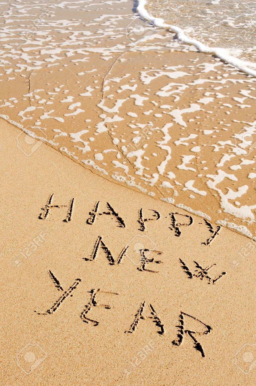 sentence happy new year written in the sand of a beach Stock Photo - 8327247