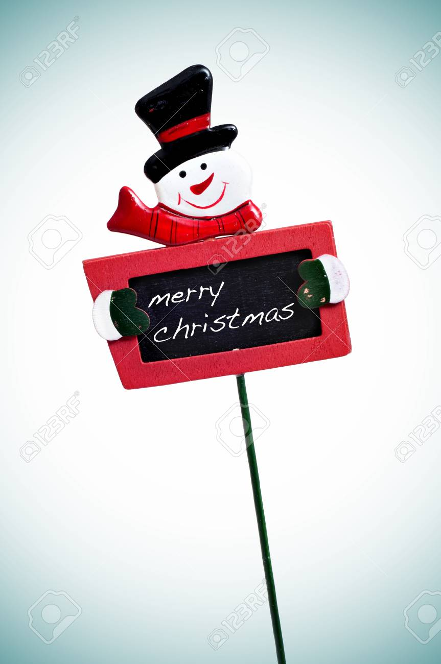 merry christmas written in a blackboard with a snowman Stock Photo - 8427247