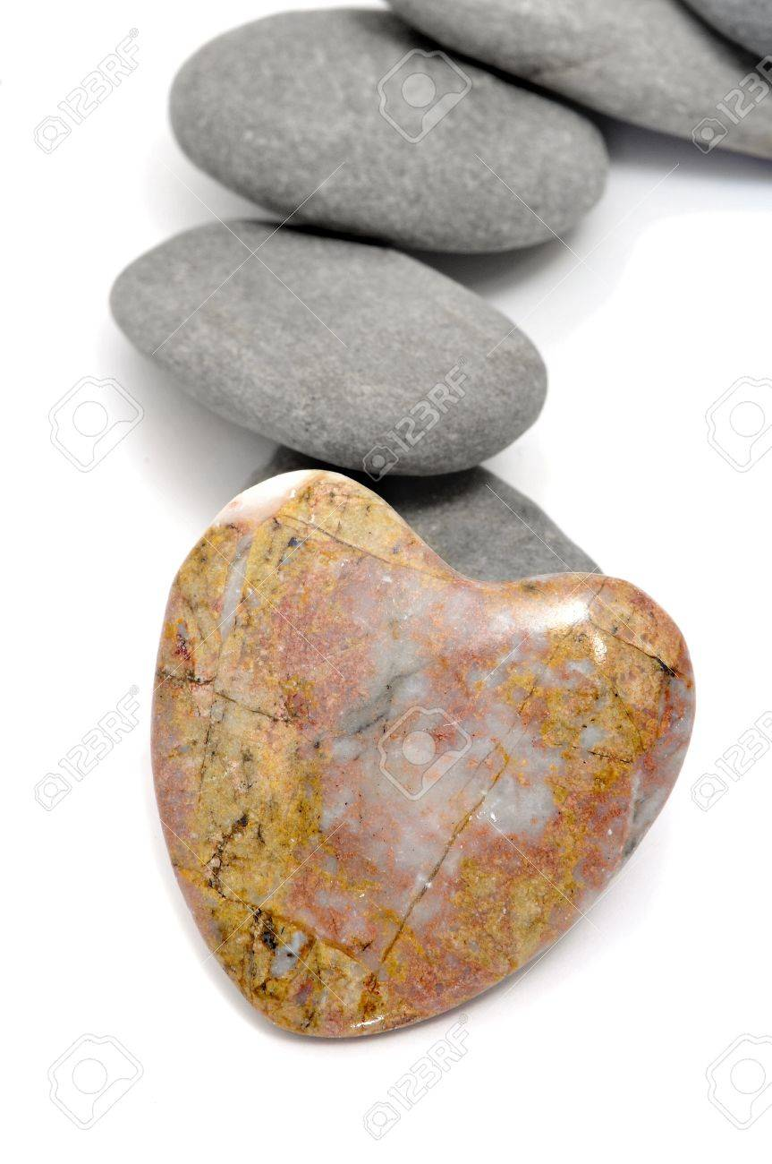 zen stones, one heart shapped, on a white background Stock Photo - 8708591