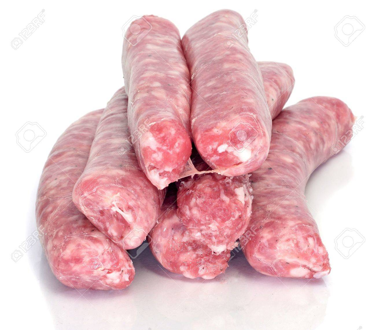 a pile of pork meat sausages on a white background Stock Photo - 9440858