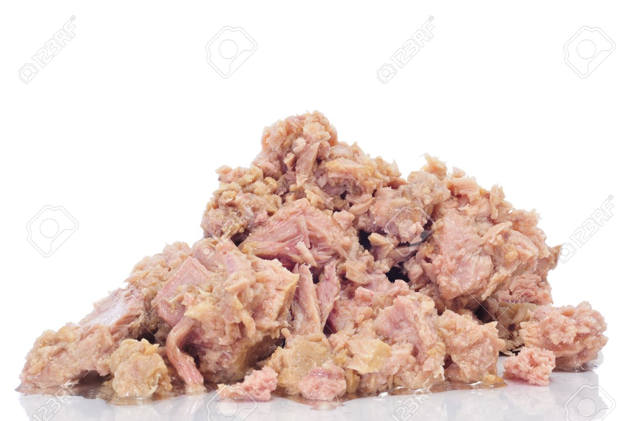 a pile of tuna from a can on a white background Stock Photo - 9550261