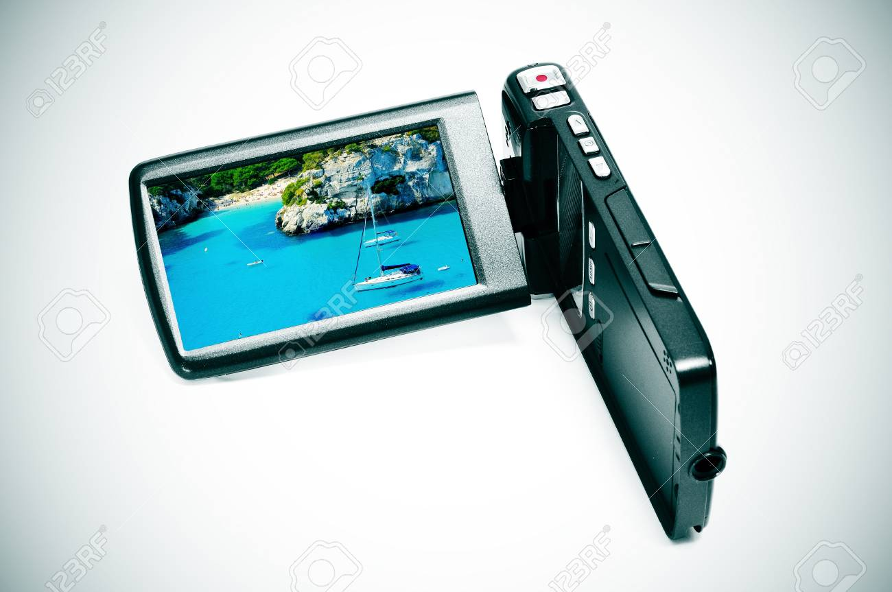 a digital video camera with an image of Macarelleta Beach in Menorca, Spain Stock Photo - 10003068