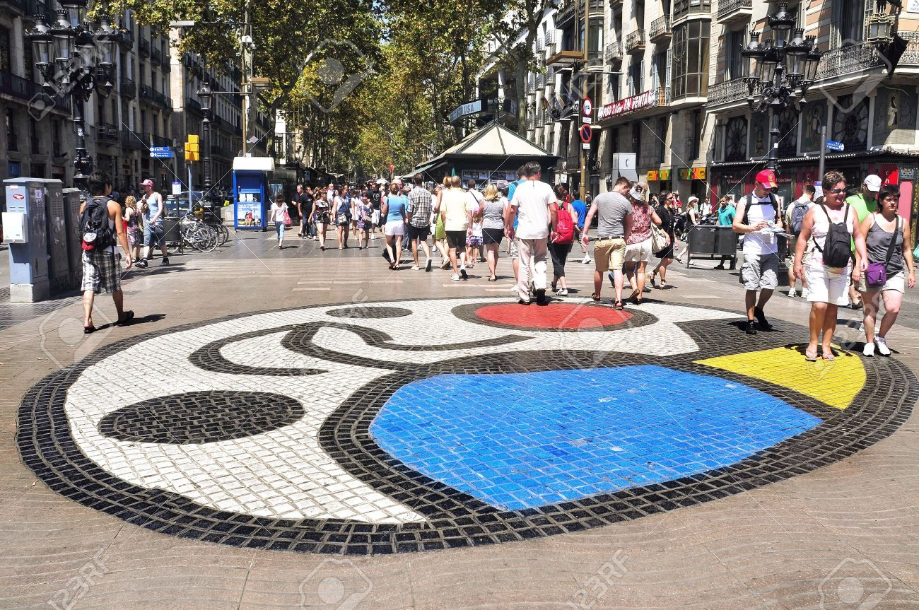 Barcelona, Spain - August 16, 2011: Joan Miro's Pla de l'Os mosaic in La Rambla, Barcelona, Spain. Thousands of people walk dayly on the mosaic, designed by famous artist Joan Miro Stock Photo - 10340053