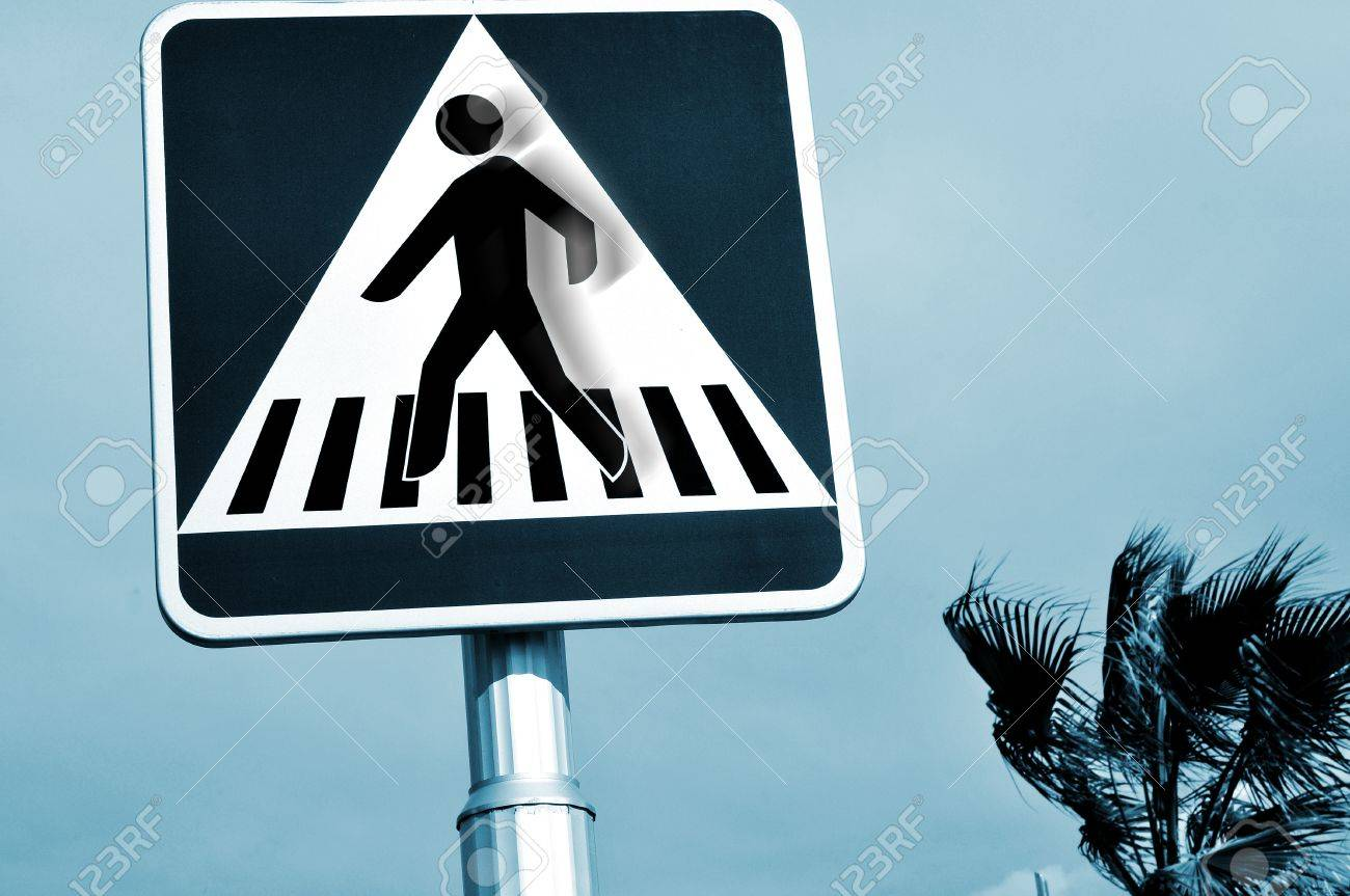 a pedestrian crossing sign with the silhouette of the person in motion Stock Photo - 10526754