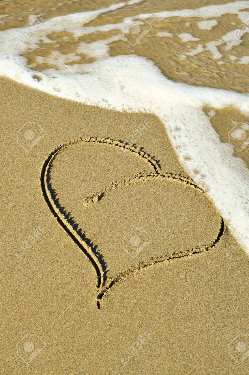 a heart drawn on the sand of a beach Stock Photo - 11231907