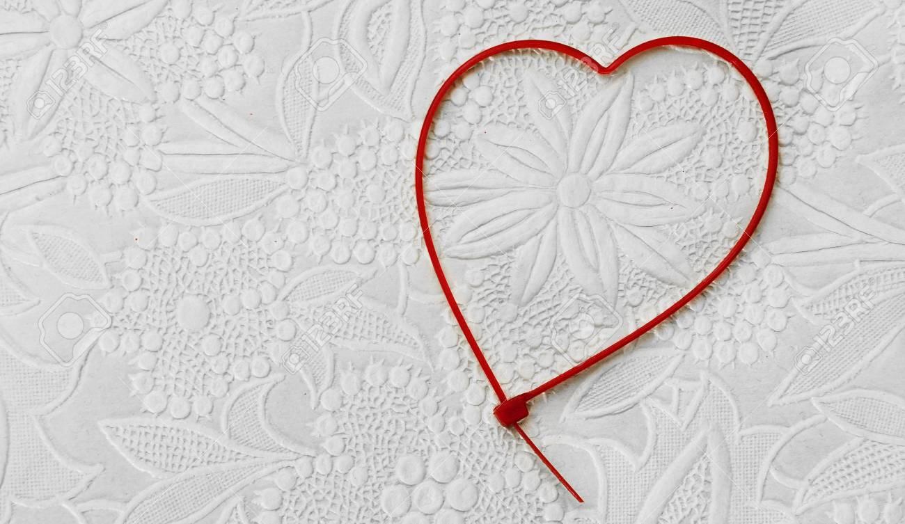 Herzförmigen Kabelbinder Auf Einem Gemusterten Hintergrund ...
