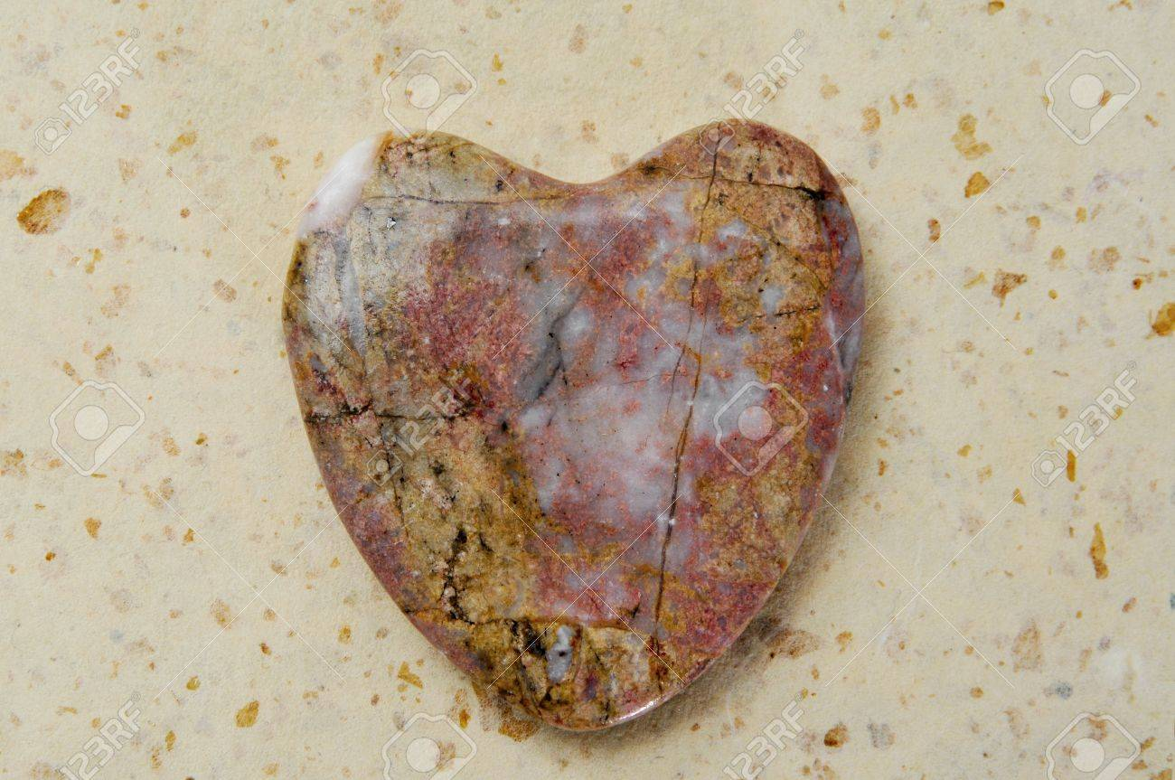 heart-shaped stone on a patterned background Stock Photo - 12553784