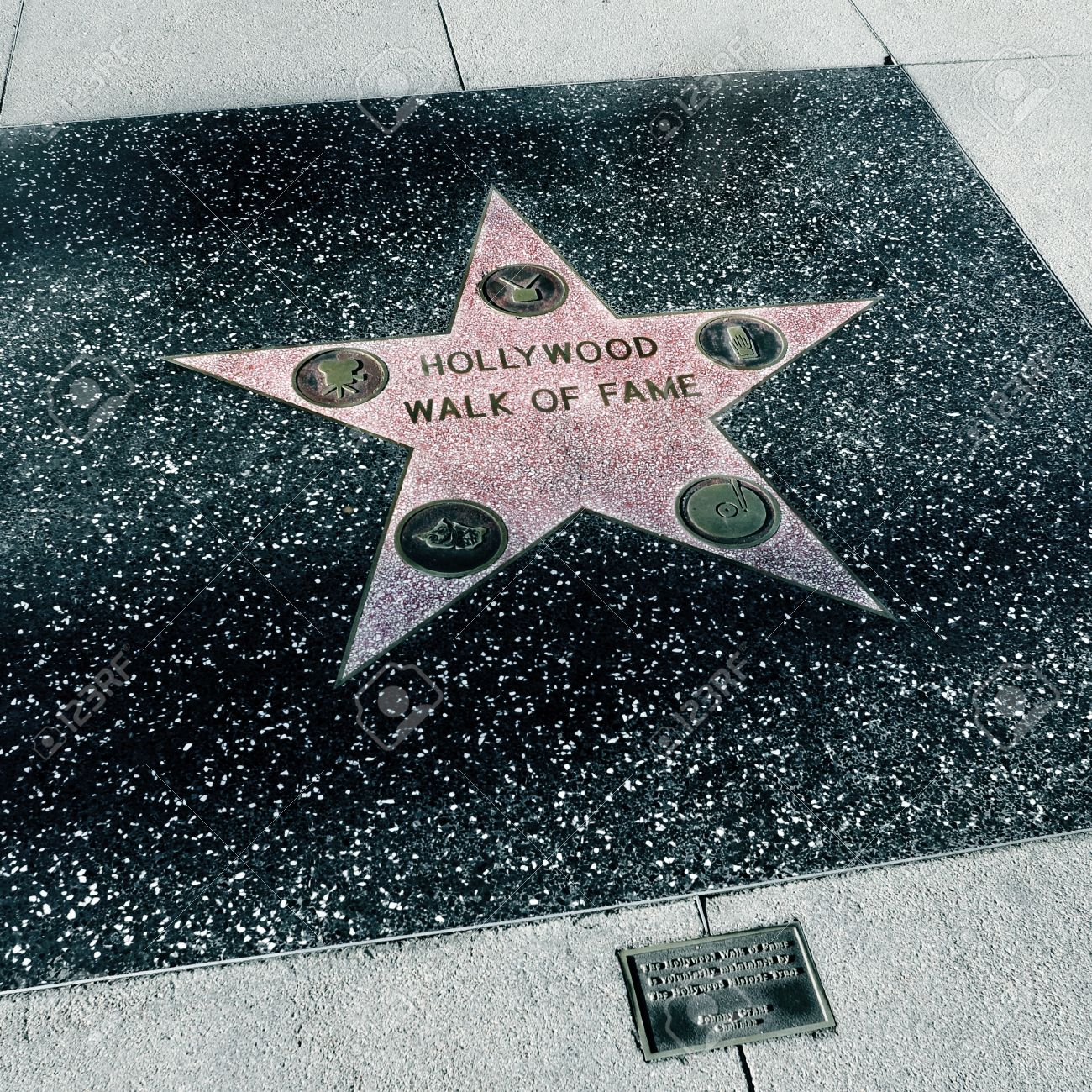Los Angeles - October 16, 2011: The star of Hollywood Walk of Fame in Los Angeles. Those more than 2,400 five-pointed stars attracts about 10 million visitors annually - 13537803