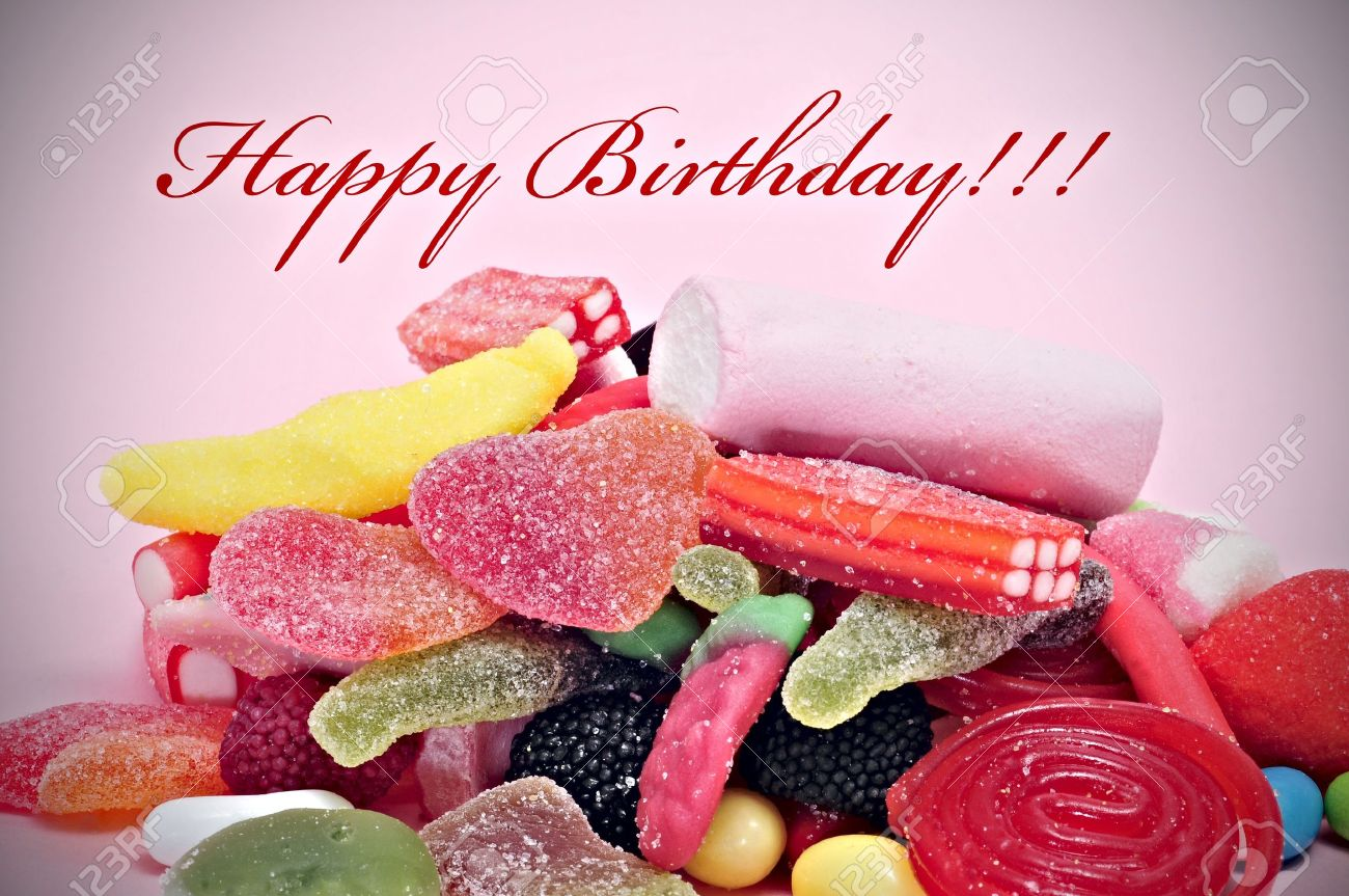 A Pile Of Candies With The Sentence Happy Birthday Written In