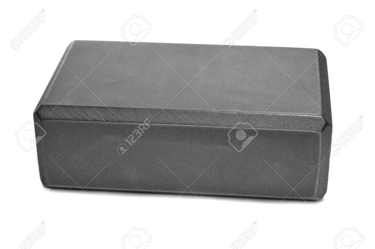 a gray yoga foam block on a white background Stock Photo - 16520359