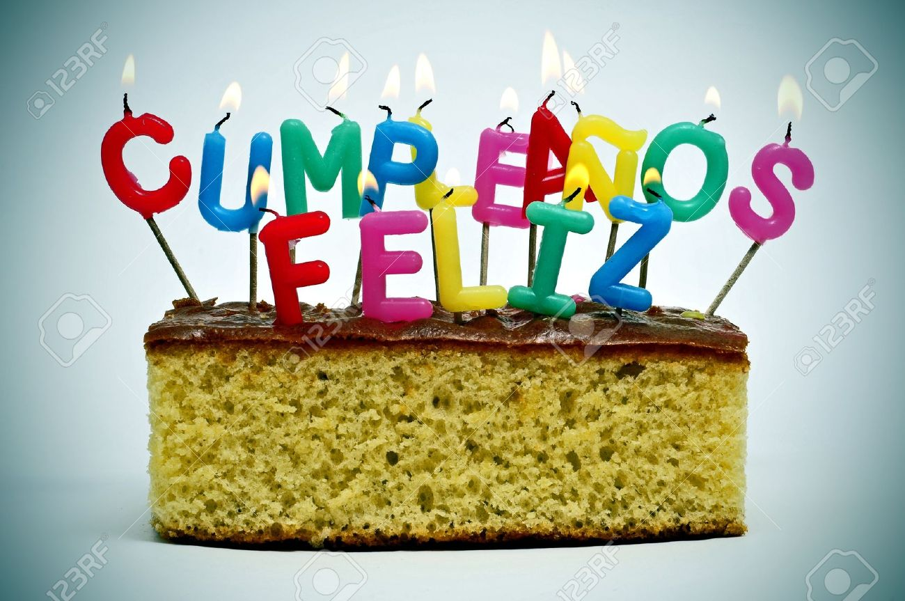 Letter Shaped Candles Of Different Colors Forming Sentence Cumpleanos Feliz Happy Birthday In Spanish