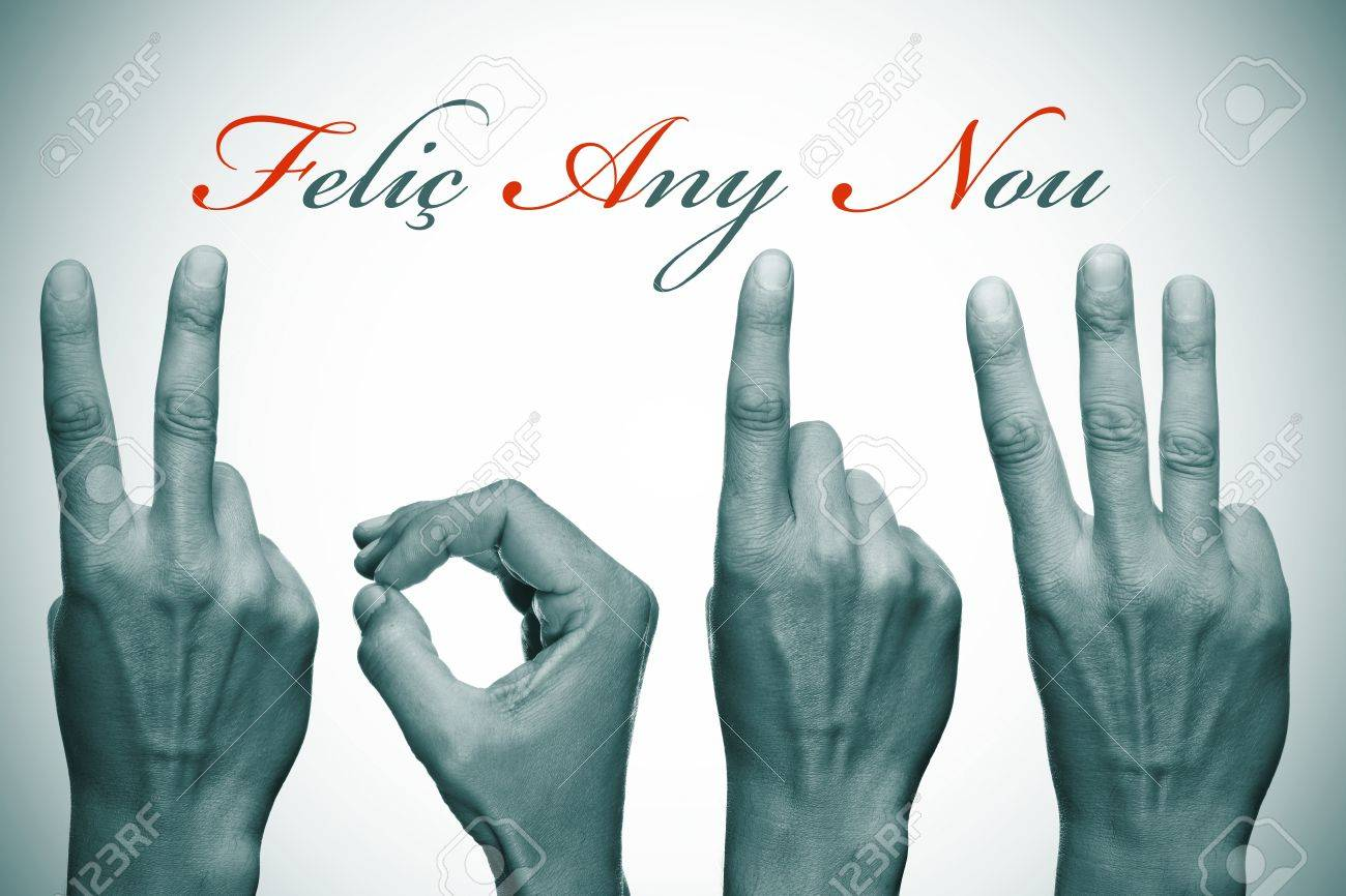 felic any nou, happy new year written in catalan, with hands forming number 2013 Stock Photo - 16921411