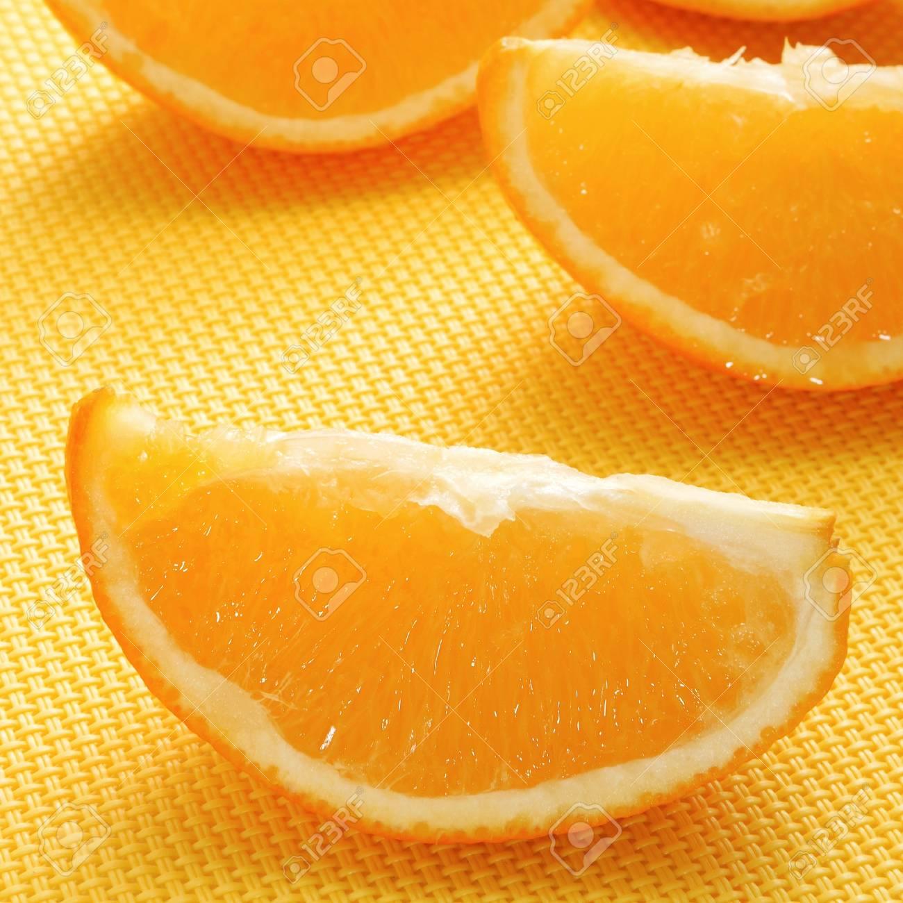 some slices of orange on an orange tablecloth Stock Photo - 17116722