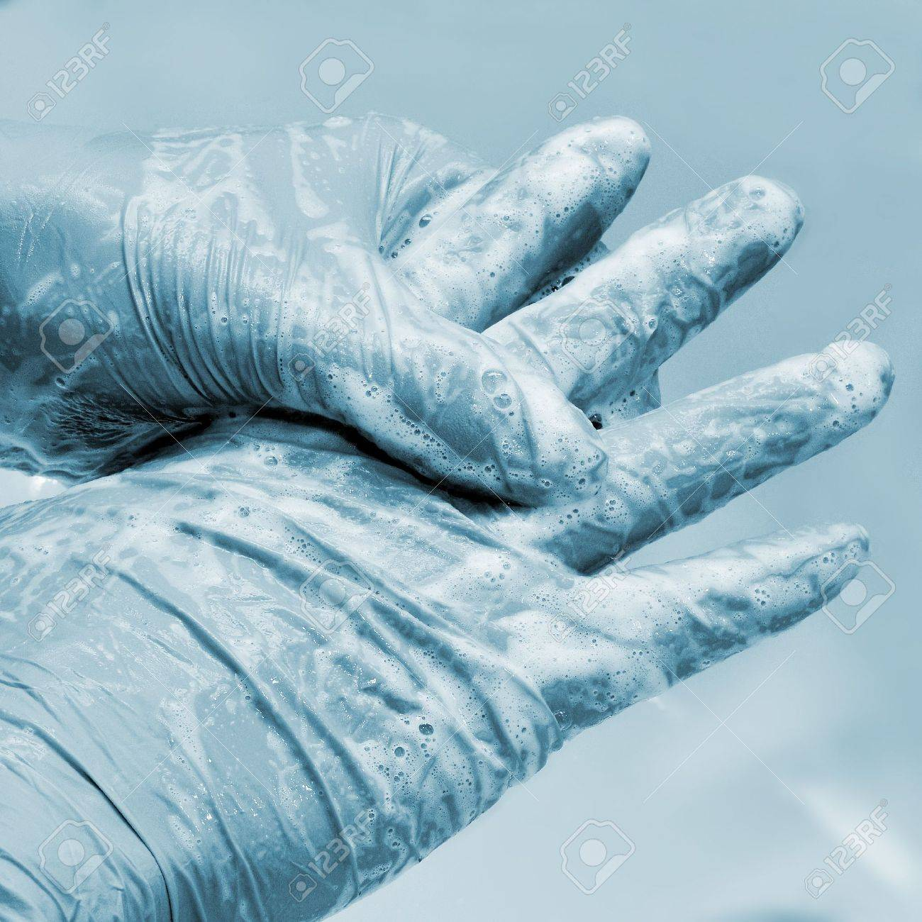 someone wearing surgical gloves washing his or her hands Stock Photo - 17127270