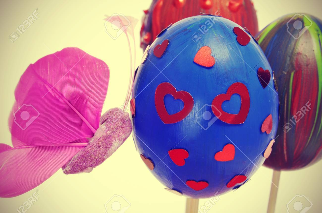 a pile of easter eggs painted in different colors and patterns, and a pink butterfly Stock Photo - 18027772
