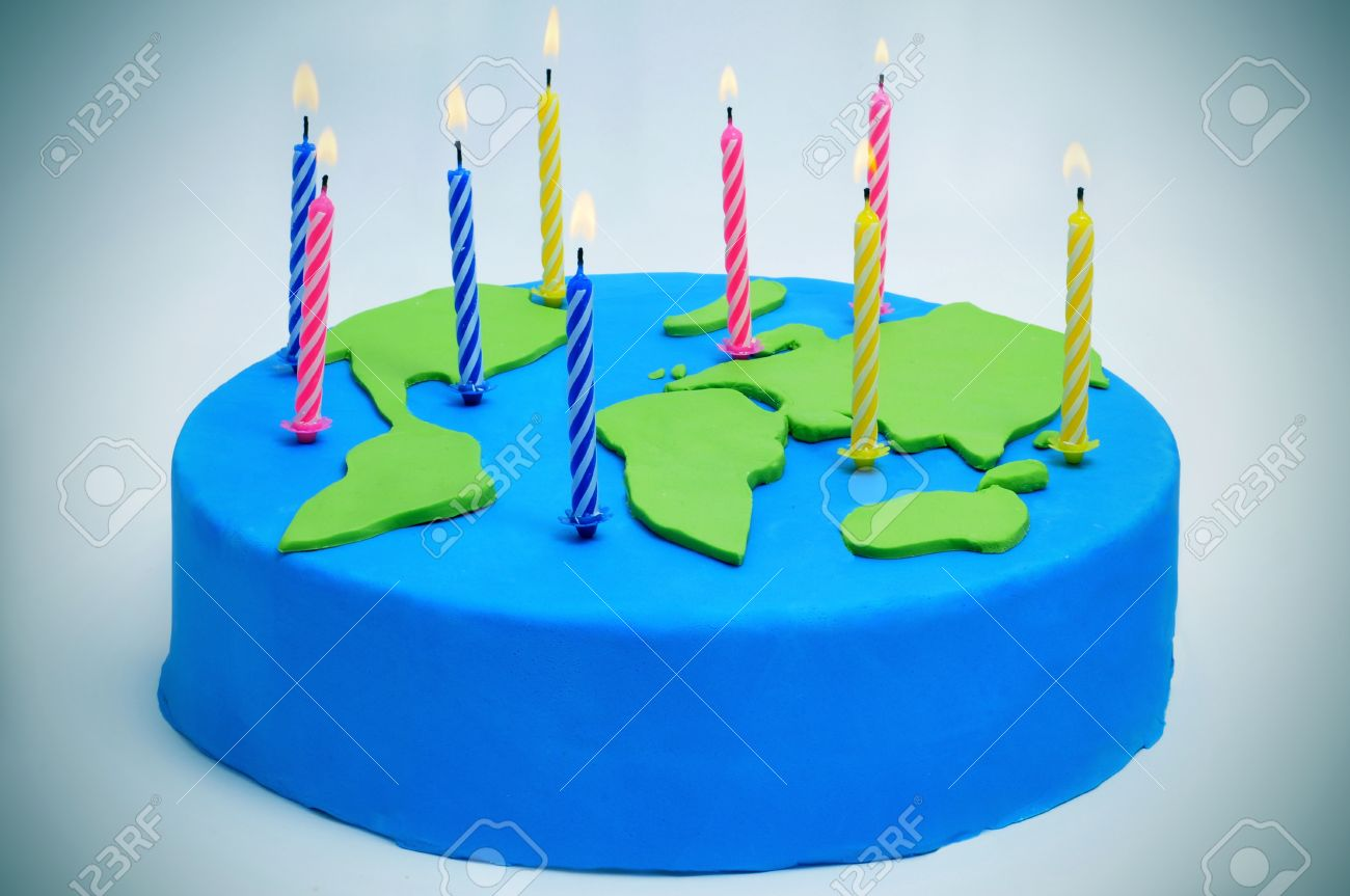 A Cake Decorated As A World Map With Candles For The International - World birthday cake