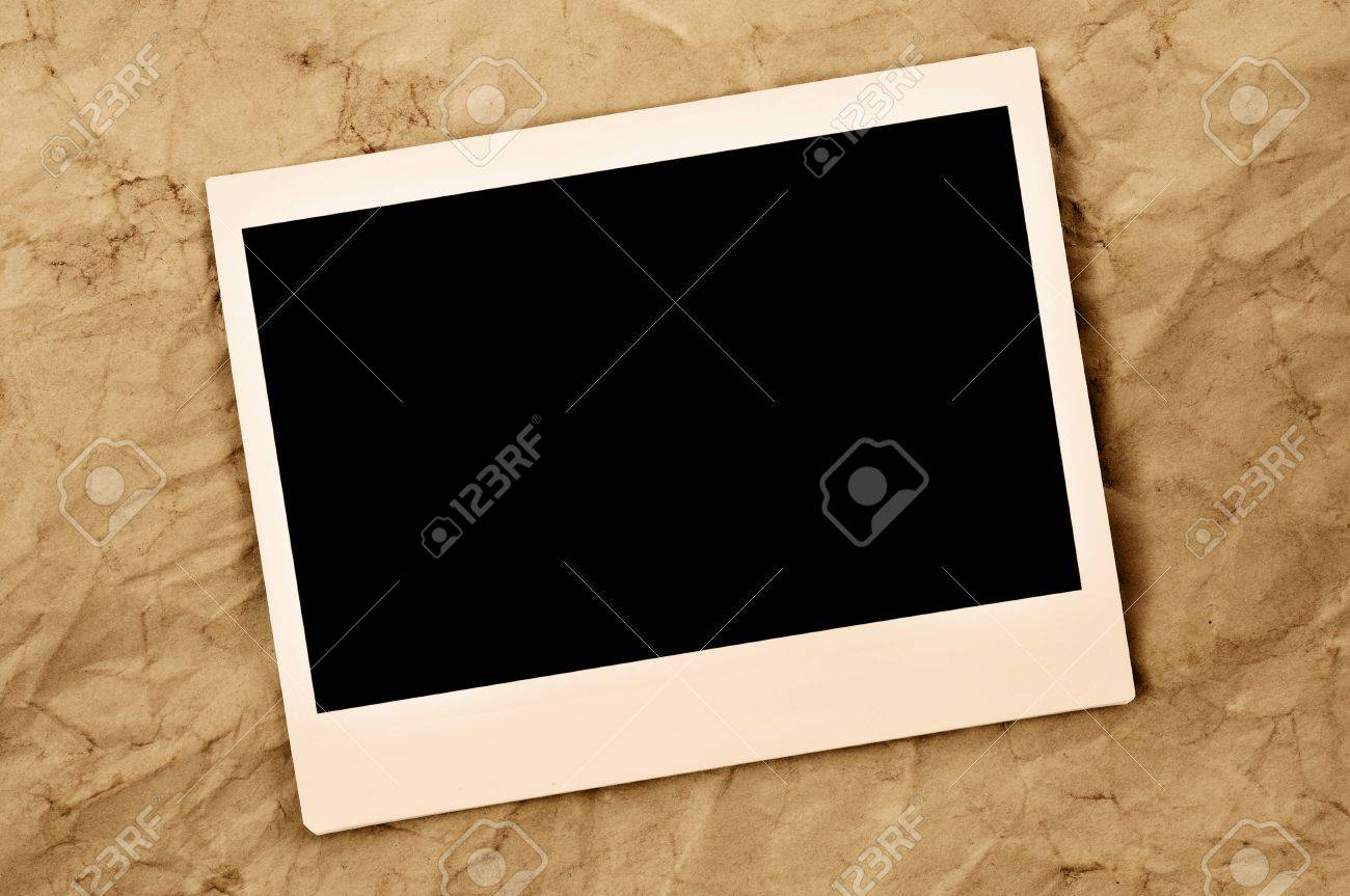 stock photo blank instant photo frame on an old paper background