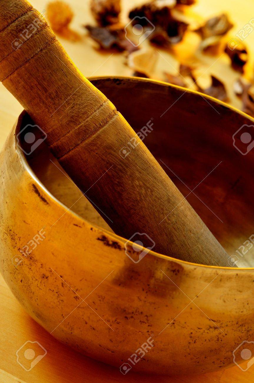 closeup of a tibetan singing bowl with its mallet Stock Photo - 21374612