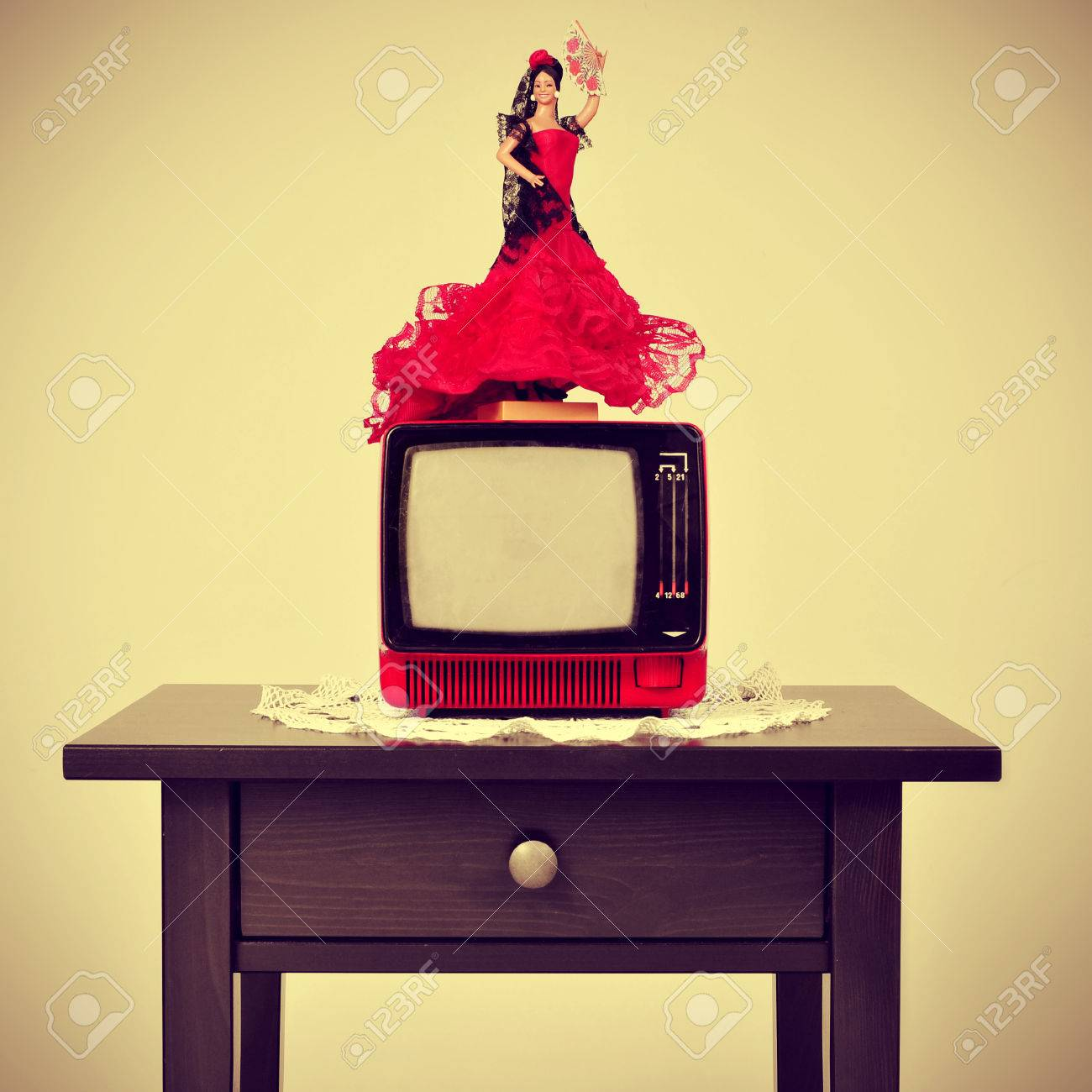 An Old Fashioned Spanish Living Room With A Flamenca Doll In Top Of The