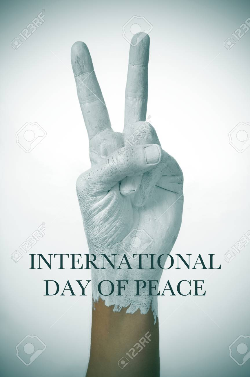 A Man Hand Painted In White Giving The V Sign As Symbol Of Peace