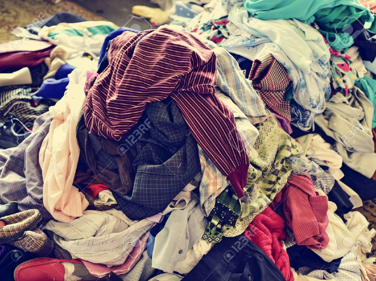 ebb6da9126 closeup of a pile of different used clothes on sale in a flea market