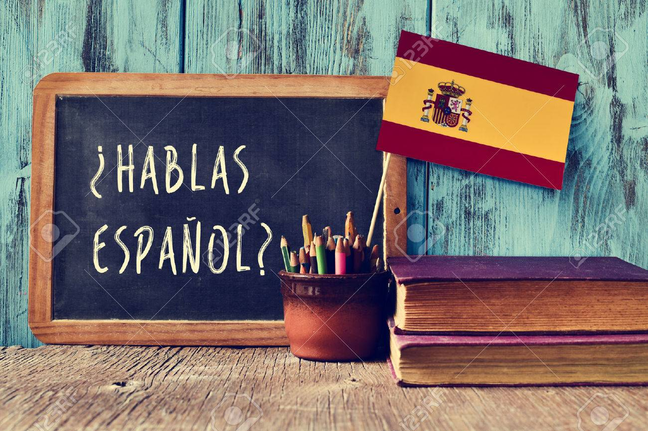 Pics photos desk with flag in background photographic print by - Spanish Flag A Chalkboard With The Question Hablas Espanol Do You Speak Spanish