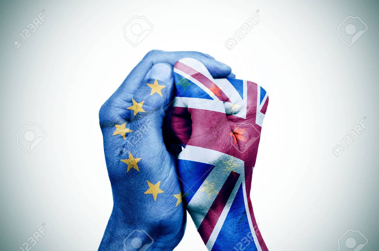 hand patterned with the flag of the European Community envelops another hand patterned with the flag of the United Kingdom Banque d'images - 52797752