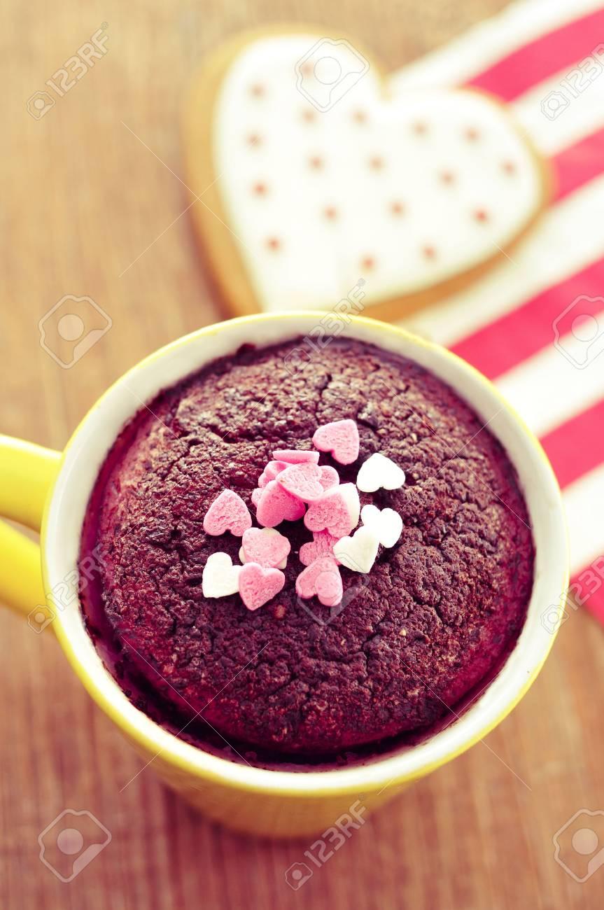 high-angle shot of a chocolate mug cake topped with heart-shaped