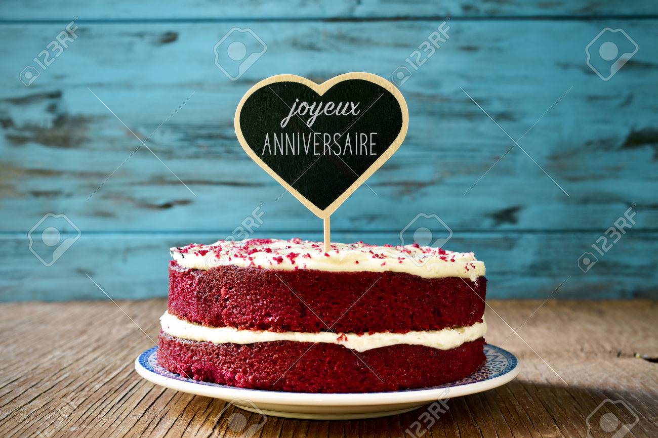 A Red Velvet Cake With Heart Shaped Chalkboard The Text Joyeux Anniversaire