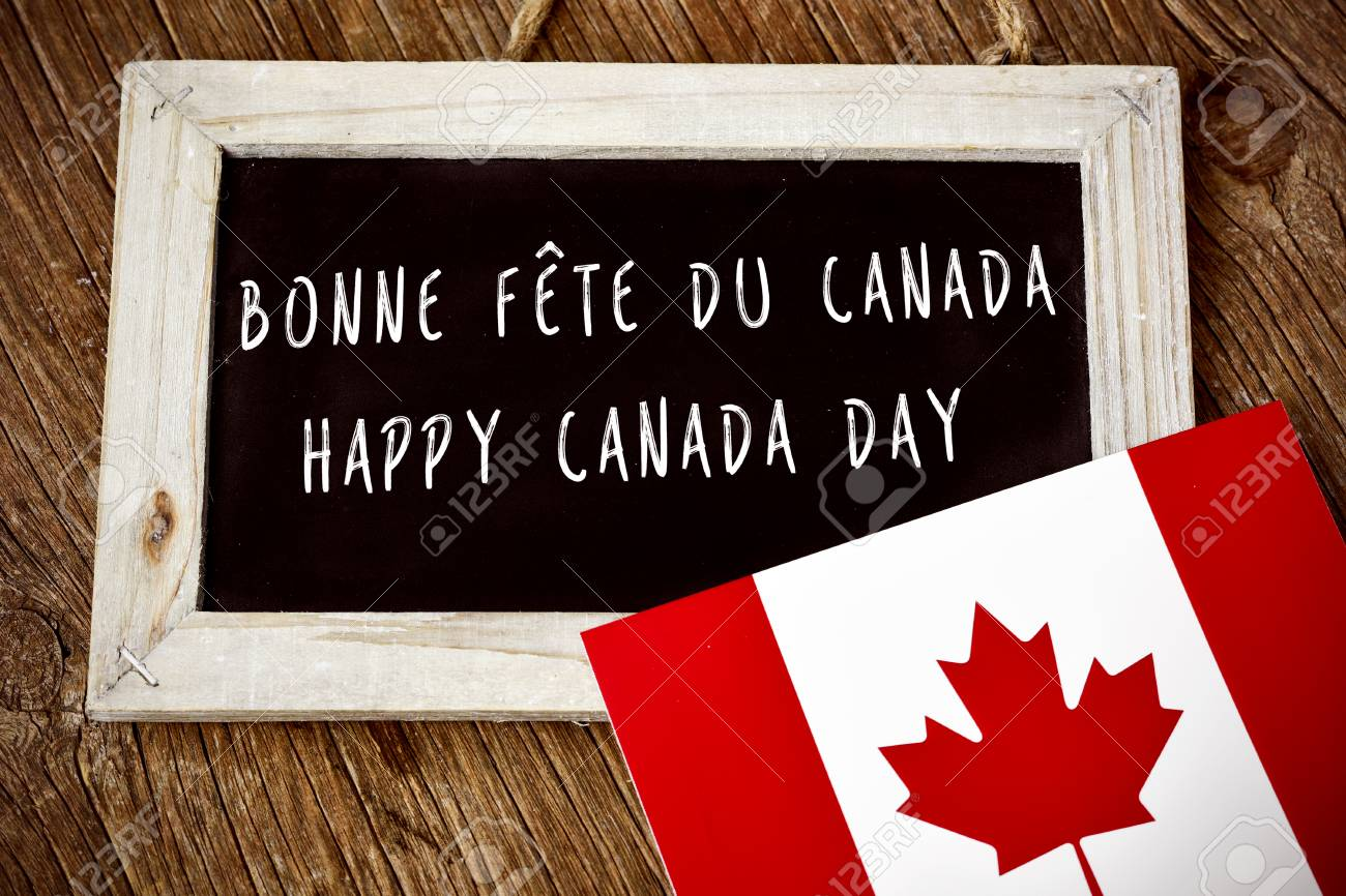 59452177-the-text-happy-canada-day-written-in-french-and-english-in-a-chalkboard-and-a-flag-of-canada-on-a-ru.jpg