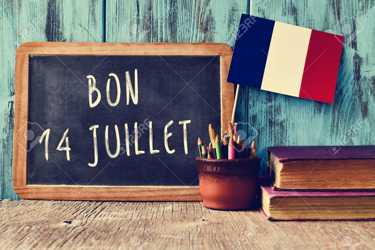 a chalkboard with the text bon 14 juillet happy 14th of july