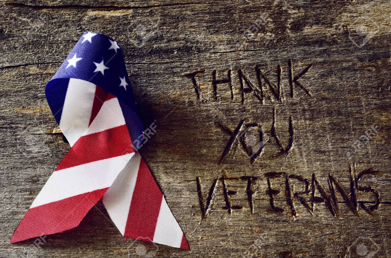The Text Thank You Veterans Carved In A Rustic Wooden Surface