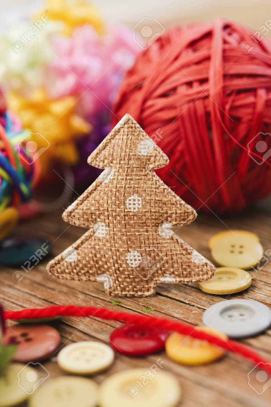 Closeup Of Some Cozy Handmade Christmas Ornaments Such As A Fabric
