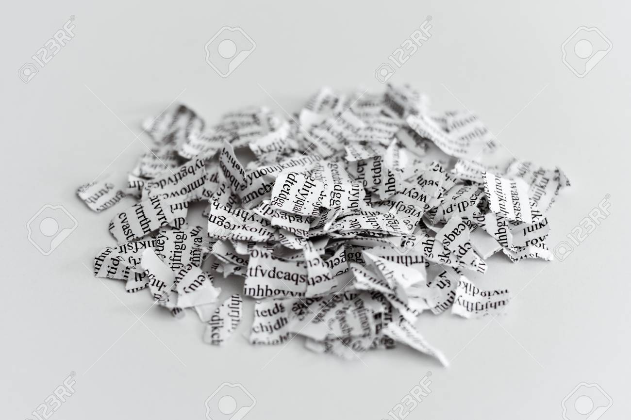 a printed letter or document broken into a thousand pieces - 73760421