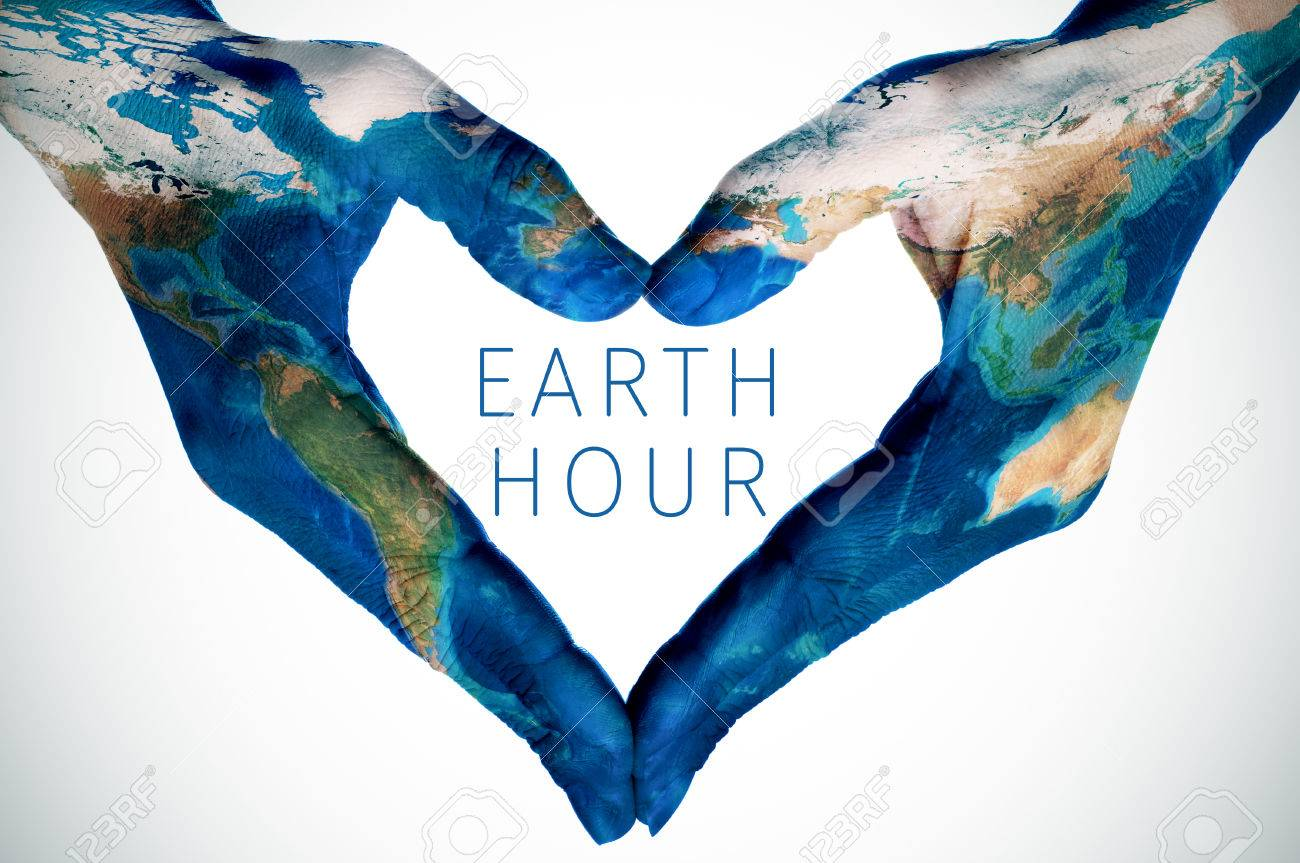 The text earth hour and the hands of a young woman patterned stock photo the text earth hour and the hands of a young woman patterned with a world map furnished by nasa forming a heart gumiabroncs Image collections
