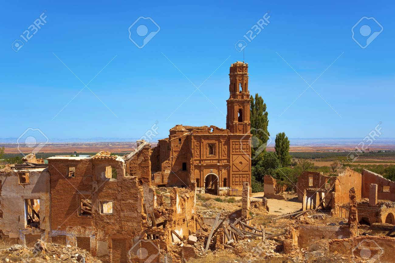 a view of the remains of the old town of Belchite, Spain, destroyed during the Spanish Civil War and abandoned from then, highlighting the San Martin de Tours church - 87483372