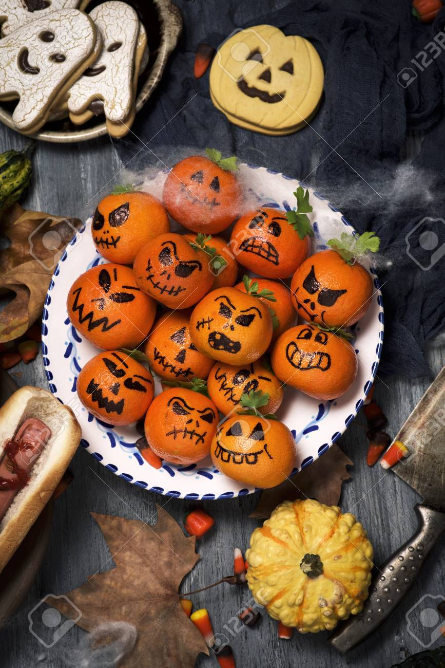 high-angle shot of some funny halloween food, such as tangerines