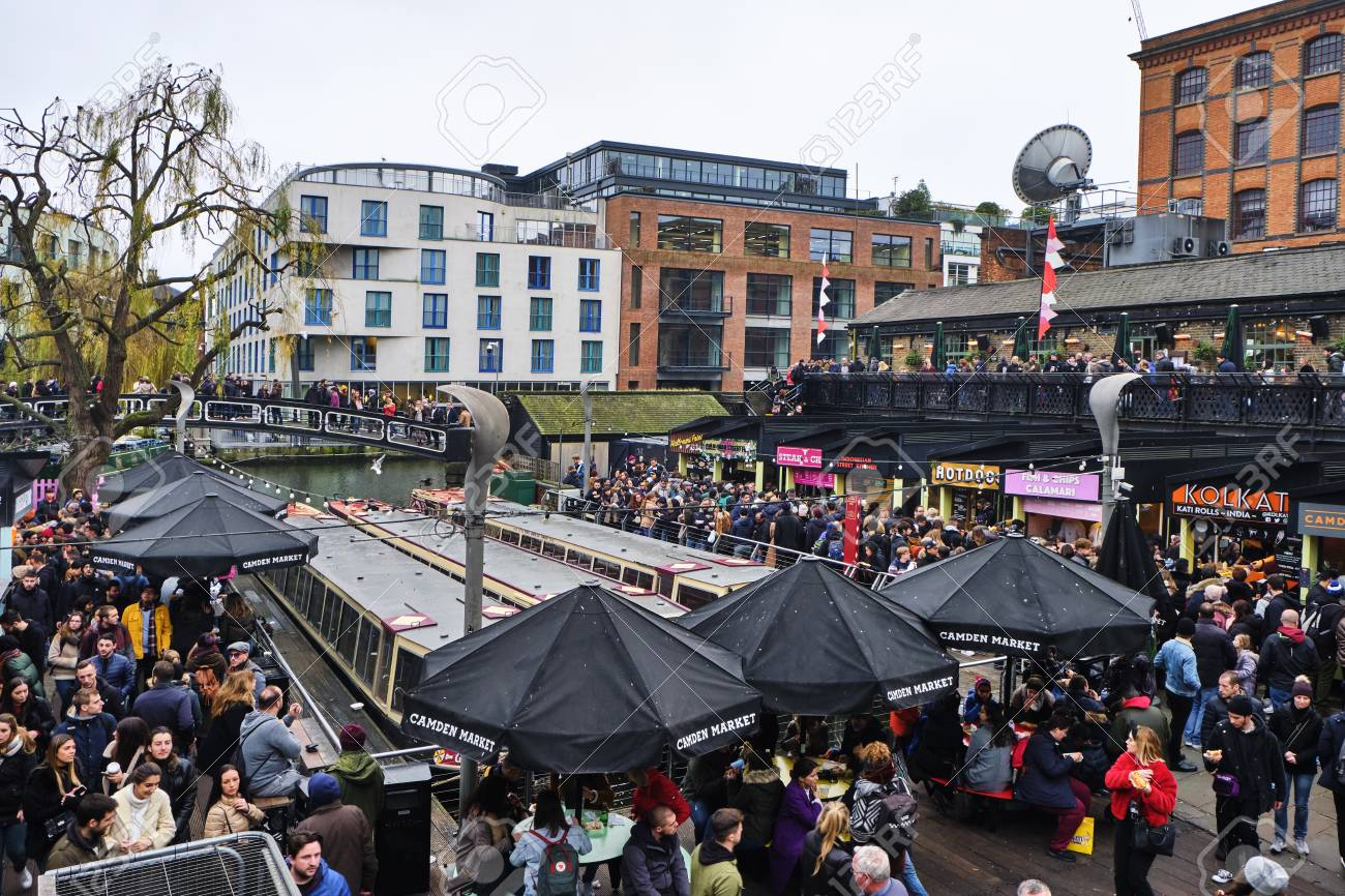 LONDON, UK - DECEMBER 30, 2018: Visitors at Camden Lock. Camden Lock, Camden Market, and streets nearby are the fourth-most popular attraction in the city, attracting 100,000 people each weekend - 120681322
