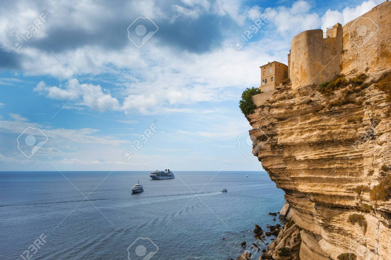 a view of the picturesque Ville Haute, the old town of Bonifacio, in Corse, France, on the top of a cliff over the Mediterranean sea - 126441372