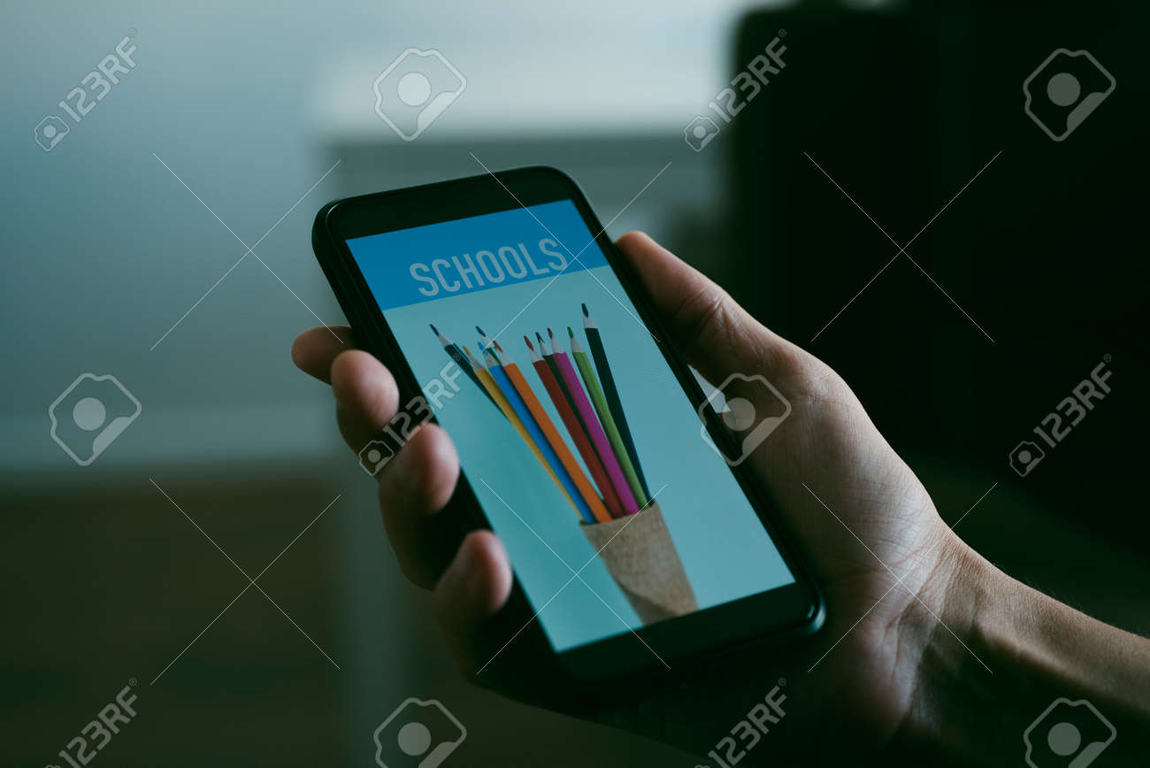 closeup of a young caucasian man is searching schools online with his smartphone, with a simulated search engine in its screen, in his living room - 172749704
