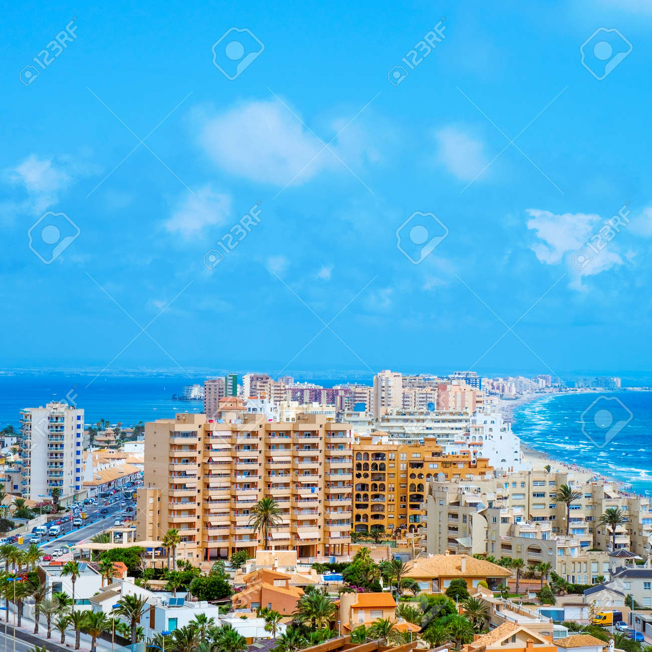 a panoramic view over La Manga del Mar Menor, in Murcia, Spain, with the Mar Menor lagoon on the left and the Mediterranean sea on the right, in a square format - 172883484