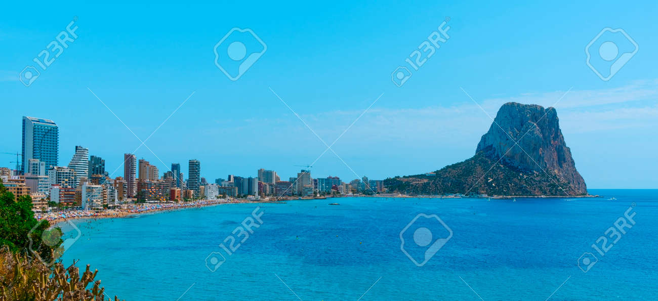 a view over Calp, in the Valencian Community, Spain, highlighting the apartment towers and the Penon de Ifac promontory on the right, in a panoramic format to use as web banner or header - 172883305