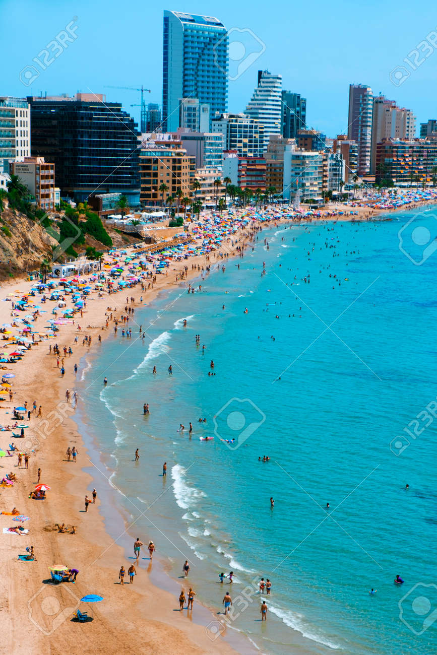 CALPE, SPAIN - AUGUST 2, 2021: A panoramic view over the main beach of Calpe, in Valencia, highlighting its characteristic apartment towers. It is an important summer tourist destination in Spain - 173421023